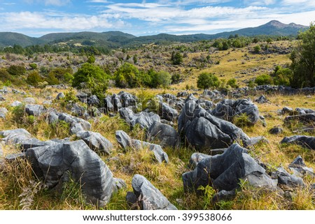 beautiful rocks and mountain landscape at Takaka Hill in New Zealand - stock photo