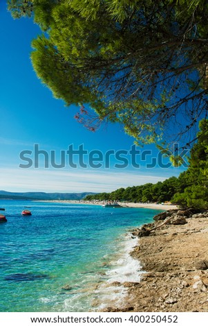beautiful rocky beach  in Croatia with a view on Zlatni Rat or Golden Cape beach, island Brac - stock photo