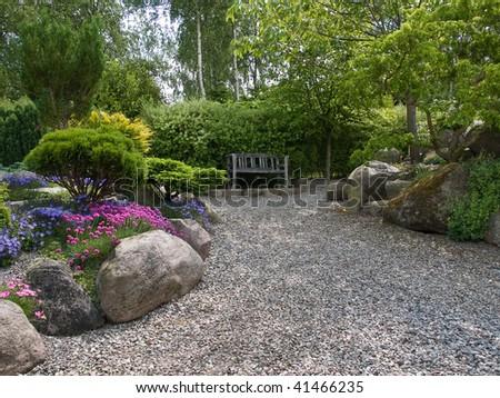 Beautiful romantic garden patio seating corner - stock photo