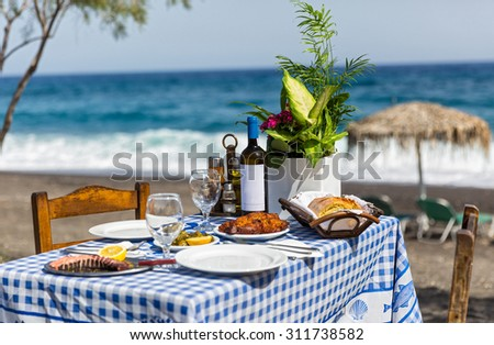 Beautiful romantic table for dinner on the sand beach