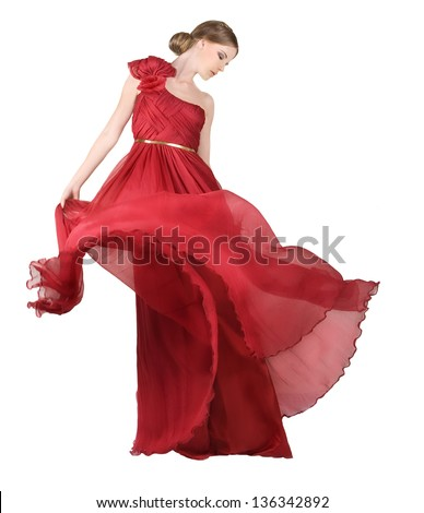 Beautiful, romantic woman in long red dress, luxurious red gown flowing... - stock photo
