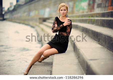 Beautiful Romantic Young Woman portrait on city embankment - stock photo