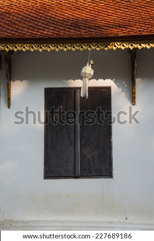 Beautiful roof tiles of temple in Chiang mai, Thailand blue sky - public - stock photo