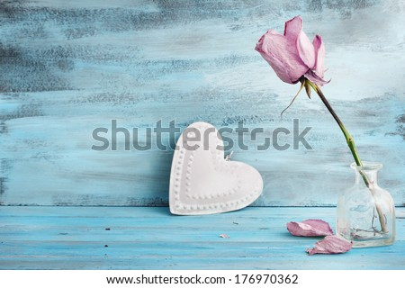 Beautiful rose and heart on romantic blue background - stock photo