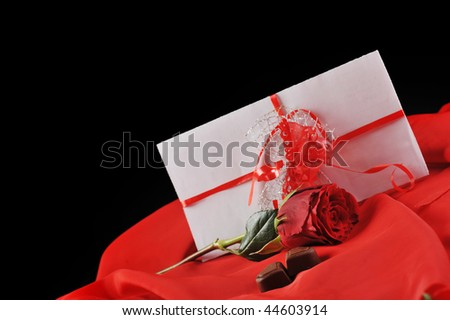 beautiful rose, and letter on red close up