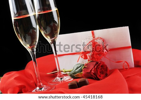 beautiful rose, champagne  and letter with ribbon close up