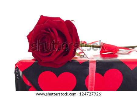 Beautiful rose with gift - stock photo