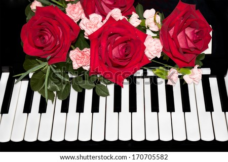 Beautiful  roses on piano