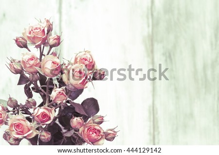 Beautiful roses on wooden background, holidays romantic background,vintage rose