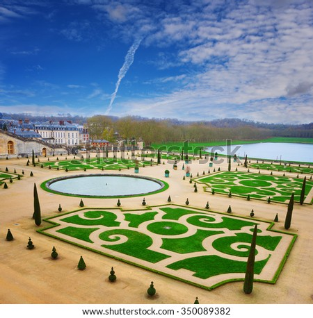 Beautiful Royal park of Versailles with neatly cut garden, France - stock photo