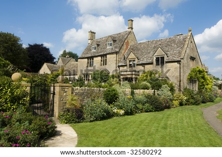 Beautiful rural Cotsworld stone homes in countryside of England - stock photo