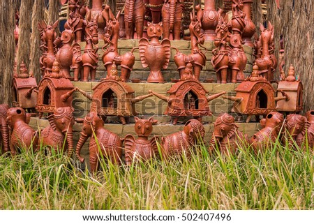 Beautiful rural Indian clay decorations of owls, horses, elephants and palanquins