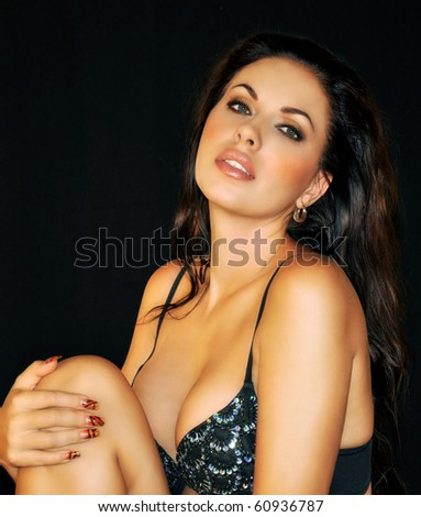 beautiful Russian brunette with sensual sexy look on black background - stock photo