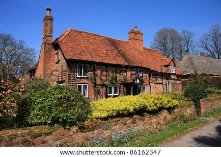 Beautiful rustic brick and timber cottage in an English village - stock photo