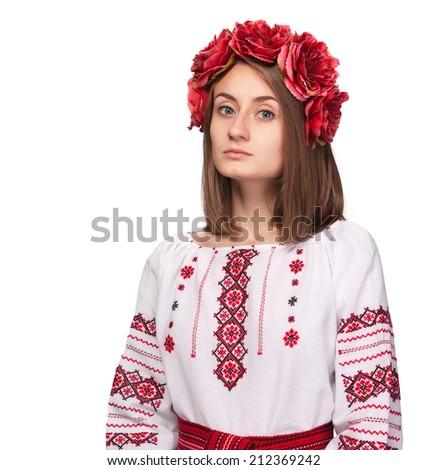 Beautiful sad girl in the Ukrainian national suit isolated on white - stock photo