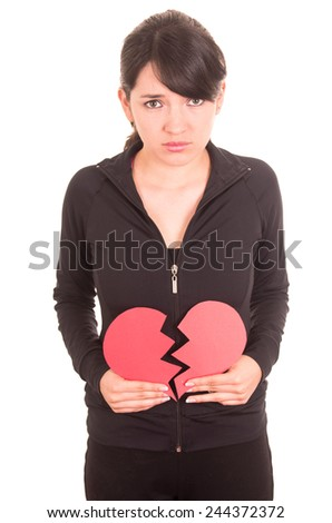 beautiful sad young girl holding a broken red heart concept of heartbreak isolated on white - stock photo