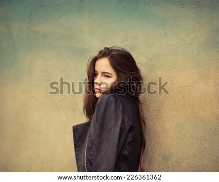 beautiful sad young woman on wall background. art Photos - stock photo