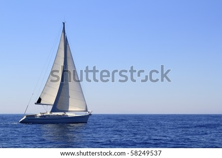 beautiful sailboat sailing sail blue Mediterranean sea ocean horizon - stock photo