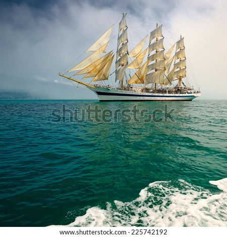 Beautiful sailing ship in the fog - stock photo