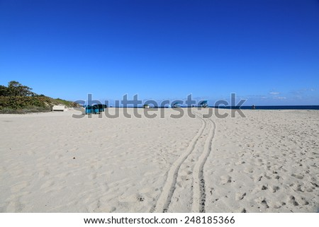 Beautiful sand beach with lounge chair cabanas - stock photo