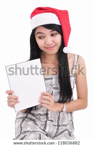 beautiful santa girl carrying blank paper isolated on white background