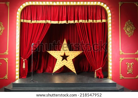 Beautiful scene in retro style with red curtain decoration large shining star - stock photo