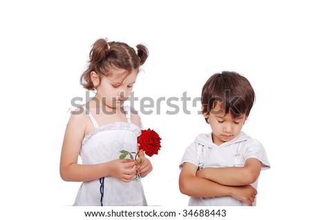 Beautiful scene of a boy and girl with rose - stock photo