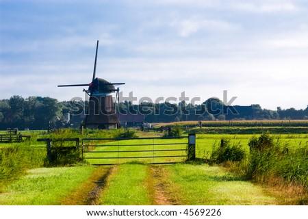 beautiful scenery of a typical dutch windmill - stock photo
