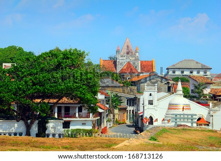 Beautiful scenery of ancient Dutch Galle Fort (UNESCO World Heritage Site) with Christian church and Buddhist stupa - view from fortification wall, southwest coast of Sri Lanka island, South Asia  - stock photo