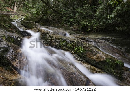 Beautiful scenery of cascaded river flowing through tropical rain forest