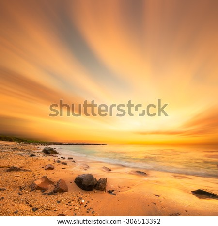 Beautiful scenery of sunset beach in Borneo.Long exposure of the sky.