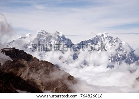Beautiful scenic landscape of snow covered mountain peaks in the Himalayas, Nepal during the summer months