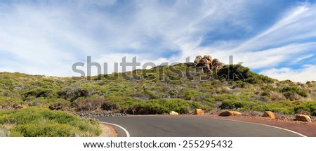 Beautiful scenic panorama of the  tourist road leading to the  remote ancient  uninhabited rocky coastline at Cape Clairault Western Australia on a fine sunny day in late autumn. - stock photo