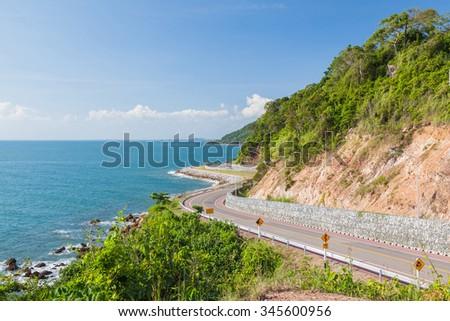 Beautiful scenic route along blue sea, Thailand - stock photo