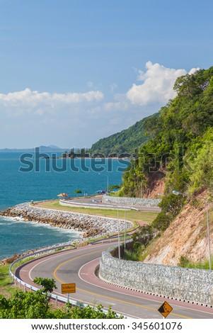 Beautiful scenic route on coast along blue sea, Thailand - stock photo