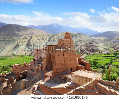 Beautiful scenic view of ancient fortress and Buddhist Monastery (Gompa) in Basgo valley against the background of distant mountain and blue sky, Leh district, Ladakh, Jammu & Kashmir, Northern India  - stock photo