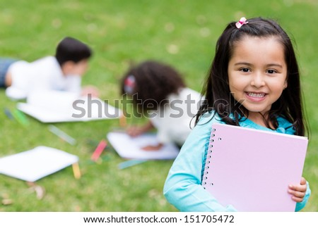 Beautiful school girl looking very happy outdoors  - stock photo