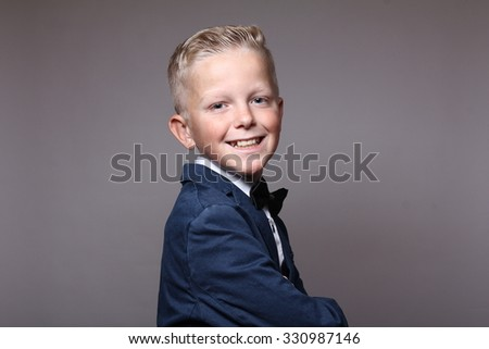 Beautiful schoolboy - stock photo