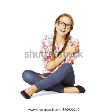 Beautiful schoolgirl with glasses, braids and beauty smile. - stock photo