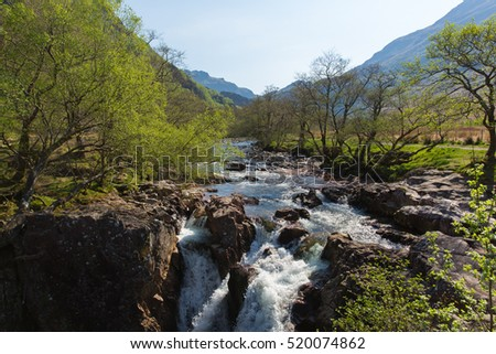 Beautiful Scottish Highlands Glen Nevis river Scotland UK with white water rocks and mountains