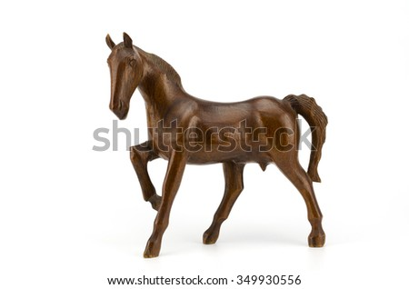 Beautiful sculpture of horse made of  wood isolated on the white background with clipping path