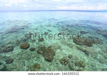 Beautiful sea and beach at tropical island - stock photo