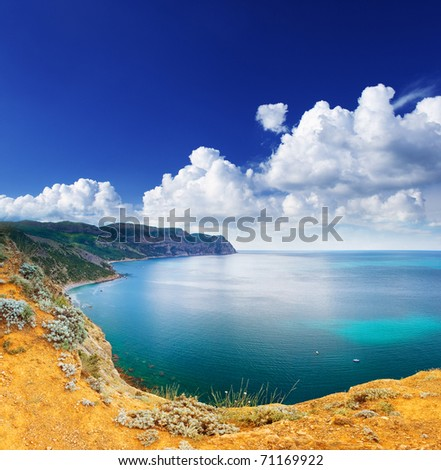 Beautiful sea and clouds sky with sun - stock photo