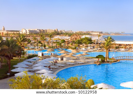 Beautiful sea and pool view in a tropic hotel. - stock photo