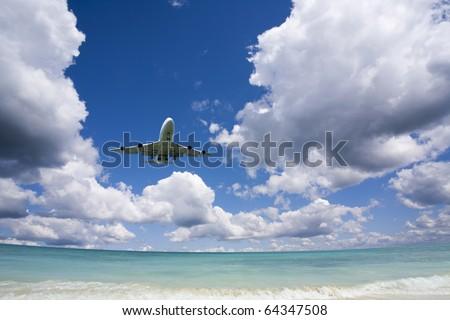 Beautiful sea and sky with airplane . - stock photo