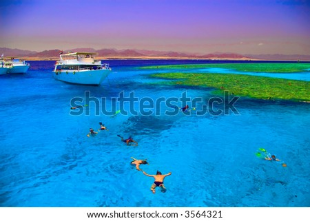 Beautiful sea landscape with swimmers and yachts