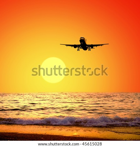 Beautiful sea nature landscape on the sunrise sky with airplane