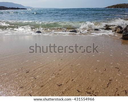 Beautiful sea, waves and sand. Tender sea. Summer holidays at sea - stock photo