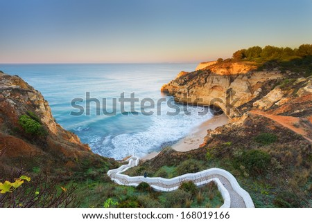 Beautiful seascape bay with serpentine steps. Portugal, Carvoeiro. - stock photo
