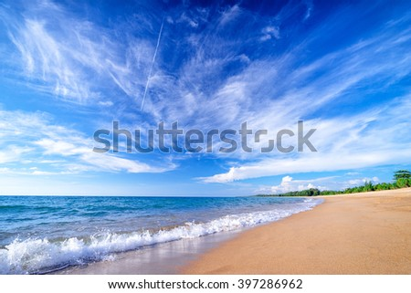 Beautiful seascape. Beach with blue cloudy sky. - stock photo